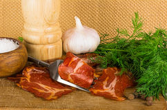 Simple farm bacon, stranded on a fork Stock Image