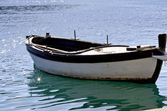 Simple fishing boat with starburst Royalty Free Stock Photos