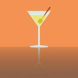 Simple flat glass of martini with olive. On orange background Stock Photography