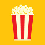Simple flat popcorn bag. On orange background Royalty Free Stock Photos