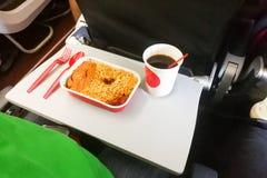 Simple in-flight meal of rice, meat, coffee in disposable utensi. Simple in-flight prepared meal of rice, meat, coffee in disposable utensils Stock Photography