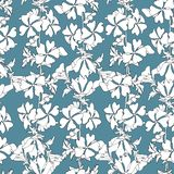 Simple floral background with white flowers on a blue background. Drawn floral textures. Blue ornament to decorate fabrics, tiles. And paper and wallpaper on royalty free illustration