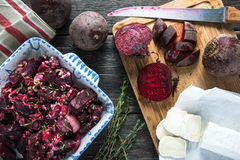 Simple food, beetroot bake with goats cheese stock photography