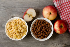 The simple food composition with apples and corn flacks Stock Photos