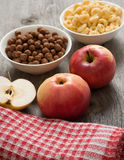 The simple food composition with apples and corn flacks Royalty Free Stock Photography