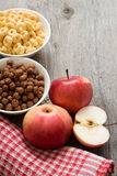 The simple food composition with apples and corn flacks Royalty Free Stock Image
