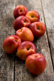 The simple food composition with nectarines on the unique backing closeup. Fresh summer fruits stock photo