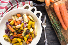 Simple food,roasted vegetables. Simple natural food,roasted vegetables in rustic tray royalty free stock photos