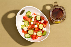 Simple fresh salad with feta cheese and hot tea Stock Image