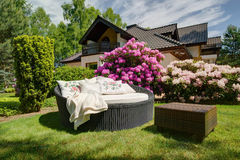 Simple garden sofa and table. Picture of simple rattan garden sofa and small table Stock Photography
