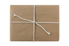 Simple gift parcel wrapped in brown paper Royalty Free Stock Photos