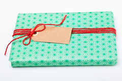 Simple gift with tag Stock Photography