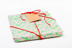Simple gift with tag Stock Images