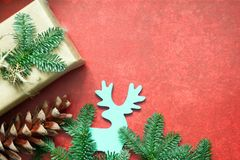 Simple gifts and fir tree christmas ornament decoration on empty red background royalty free stock images