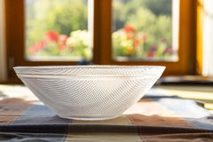 Simple glass bowl on a table Stock Image