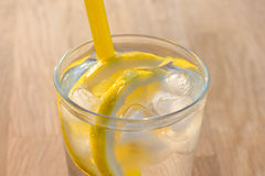 Simple glass of ice water with lemon slices Royalty Free Stock Photography