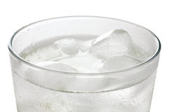 Simple glass of water with floating ice cubes Stock Photo