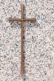 A simple gold memorial cross on a polished light pink granite sl Stock Images