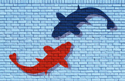 Simple graffiti. Sharks on painted brick wall Stock Images