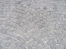 Simple gray cobblestones from the streets of Krakow Poland. The feet that have trod and the stories held Stock Photos