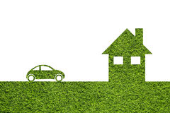 Simple green eco house and eco car grass background Royalty Free Stock Image