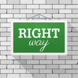 Simple green sign with text `Right Way` hanging on a gray brick wall Grunge brickwork background, textured rough surface. Simple green sign with text `Right Way Stock Photos