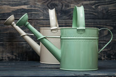 Simple Green and White Metallic Watering Cans Stock Photos