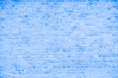 Simple grungy blue and white brick wall with light gray shades seamless pattern surface texture background.  stock image