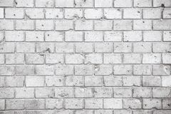 Simple grungy grey white brick wall with light and dark gray shades seamless pattern surface texture background. Wall weathered. Simple grungy grey white brick royalty free stock photography