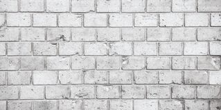Simple grungy grey white brick wall pattern surface texture wide panorama banner background stock photos