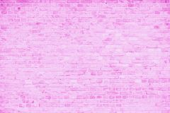 Simple grungy pink and white brick wall with light gray shades seamless pattern surface texture background.  stock image