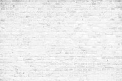 Simple grungy white brick wall as seamless pattern texture background.  Royalty Free Stock Photo