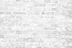 Simple grungy white brick wall with light and dark gray shades seamless pattern surface wall texture background. White brick wall background royalty free stock photography