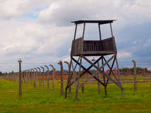Simple guard post and barbwire fence Royalty Free Stock Images