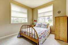 SImple guest bedroom with wood old bed. Royalty Free Stock Image