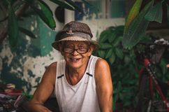 Simple happy. An old guy with simple life Stock Images