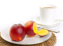 Simple healthy breakfast. Fresh nectarines with hot drink Stock Photos