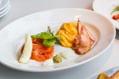 Simple healthy breakfast smoked salmon, ham, scrambled eggs Stock Photography