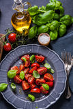 Simple and healthy dish, tomato and basil Stock Photo