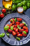 Simple and healthy dish, tomato and basil Royalty Free Stock Photos