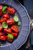 Simple and healthy dish, tomato and basil Stock Photos