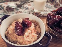 Simple healthy food. Oatmeal with dates and milk. Ramadan food Stock Image