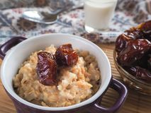 Simple healthy food. Oatmeal with dates and milk. Ramadan food Royalty Free Stock Images