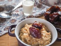 Simple healthy food. Oatmeal with dates and milk. Ramadan food Stock Photography