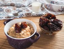 Simple healthy food. Oatmeal with dates and milk. Ramadan food Royalty Free Stock Photography