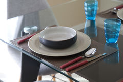 Simple home table setting. Glasses and cutlery and green plant Royalty Free Stock Image
