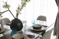 Simple home table setting. Glasses and cutlery and green plant Royalty Free Stock Images