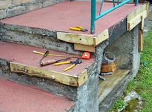 Simple homemade repair of the destroyed concrete porch Stock Photo