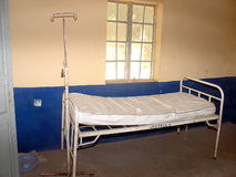 Simple hospital bed and mattress royalty free stock photos