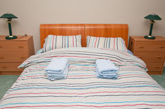 Simple hostel or hotel bedroom. Simple and generic looking hostel or hotel accommodation with comfortable bedding Stock Photos